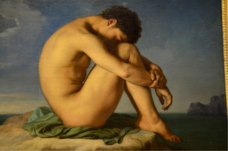 image of nude seated with knees pulled to chest and head down