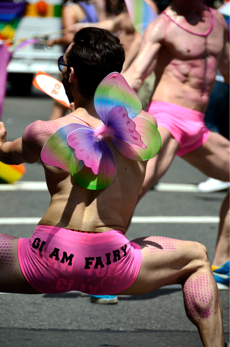 image of man in pink spandex shorts that say GI Am Fairy