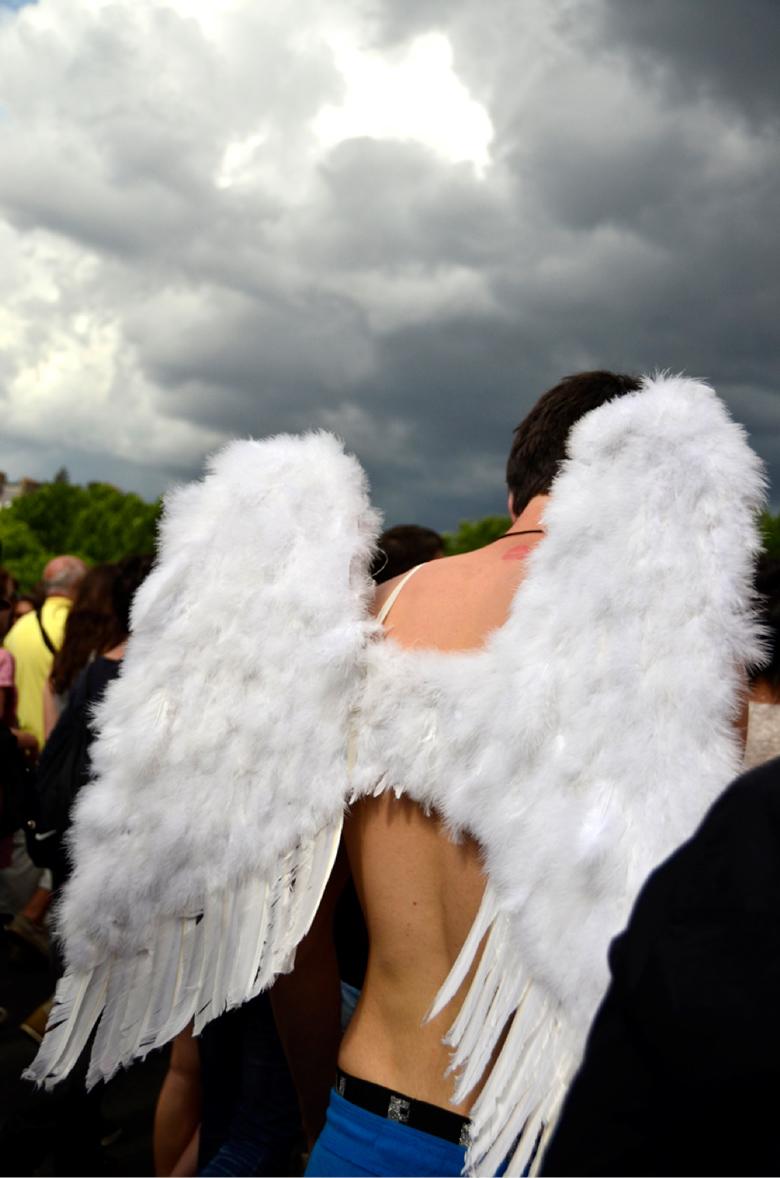 image of man wearing angel wings